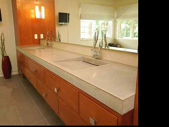Custom Floating Concrete sink in commercial bathroom