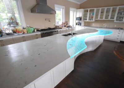 Seashells in huge long Concrete Countertop with Textured Glass component in Sarasota Florida with LED light