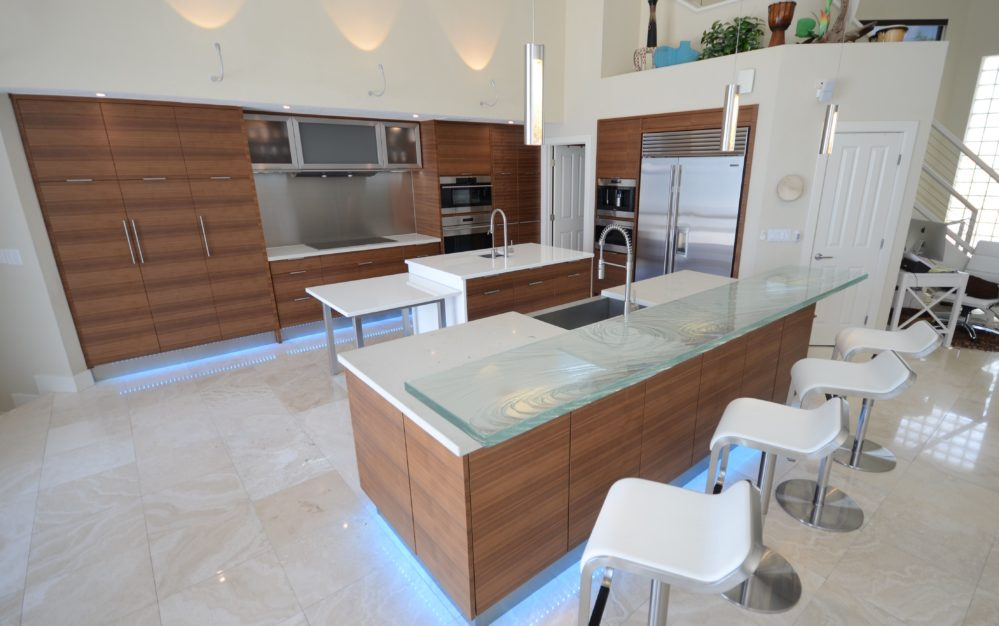 Modern Kitchen design in Tampa Florida with Textured Glass High bar, White Glass and Concrete countertops