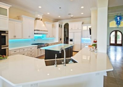 White Glass Countertop in modern kitchen in St petersburg Florida with textured glass backsplash