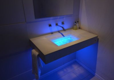 Custom Concrete and Glass Floating Bathroom Sink in Tampa Florida Downing Designs  Tampa Florida LED Lights Modern Bath showroom blue lights modern contemporary