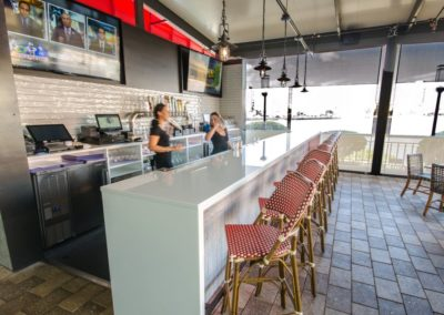 White Glass outdoor Countertop Bar with waterfall edge at American Social restaurant in Tampa Fl