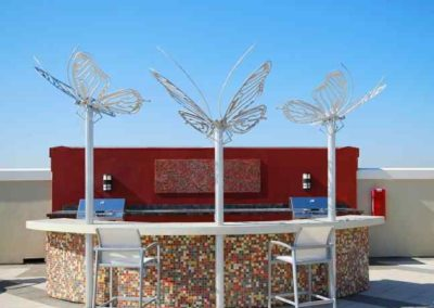Outdoor Bar Top Concrete countertop in St petersburg with metal design by Rustic Steel Creations in St Petersburg Florida apartment rooftop bar