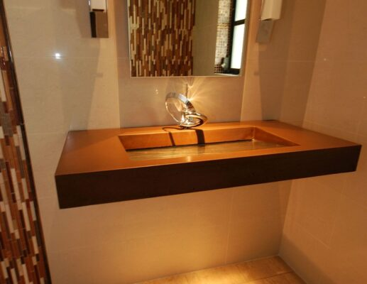 Floating Concrete and Glass sink with textured glass basin in Tampa Florida in golden brown color