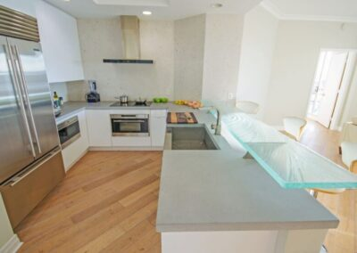 """2"""" Thick Concrete Countertop with Textured Glass High Bar in modern Channelside Tampa home"""