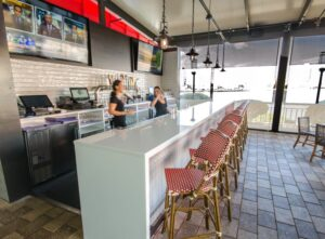 White Countertop outdoor Bar with waterfall edge at American Social restaurant in Tampa Fl