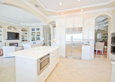 White Glass Countertops in Shaker style kitchen...beautiful in St petersburg Florida island top