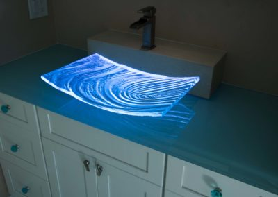 Novel Custom Glass Sink with Textured Glass LED light by Downing Designs in Tampa Florida
