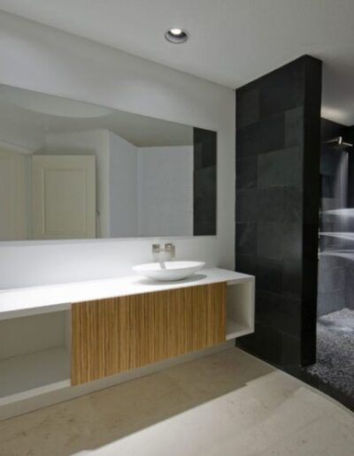 Custom Floating Bathroom Vanity with White Glass Countertop in Tampa Florida Downing Designs Design Center Modern Bath showroom