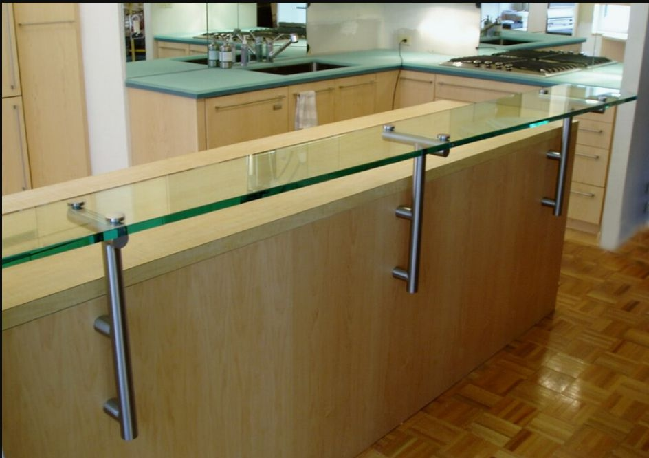 Glass Countertop with Hockey Pucks and Archaic supports