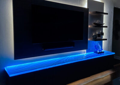Floating wall cabinet with custom Glass Countertop illuminated by LEDs
