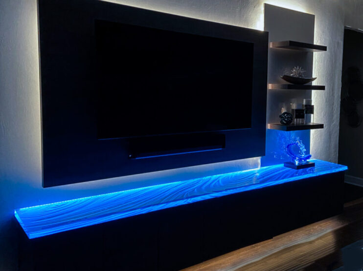 """Buy a Custom Glass Countertop 1.5"""" Thick Blue Glass Countertop atop floating cabinet in Sarasota"""